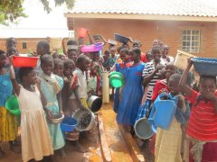 Chisanja - women and children at taps