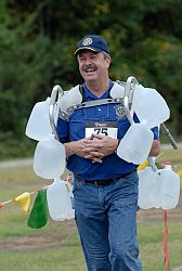 Leigh Hudson, PDG, used a walker as a unique way to carry water in the 1-Mile Water Carry Challenge.